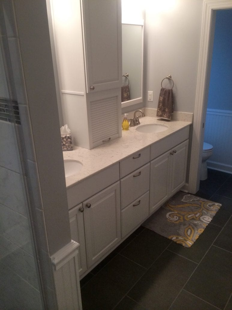 Narrow white bathroom cqc remodel