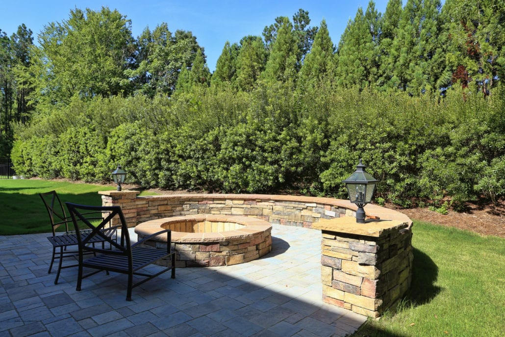 Stone Patio with Fire Pit and Zuri Decking and Cable Railings
