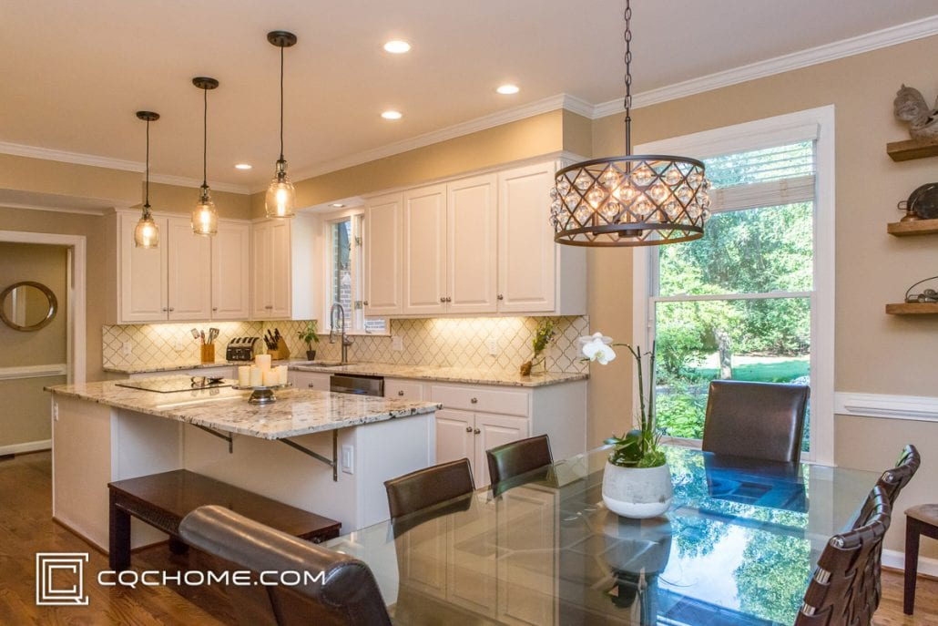 updated kitchen with four pendant lights