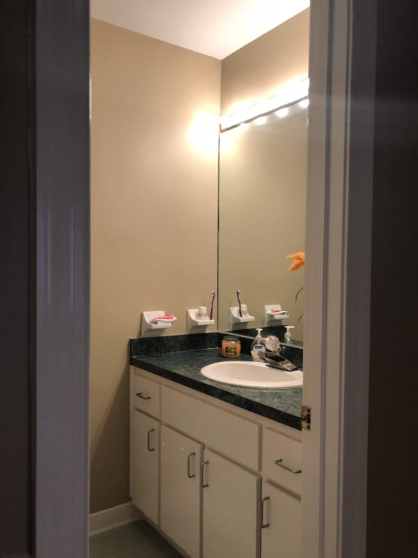 before of small outdated bathroom vanity