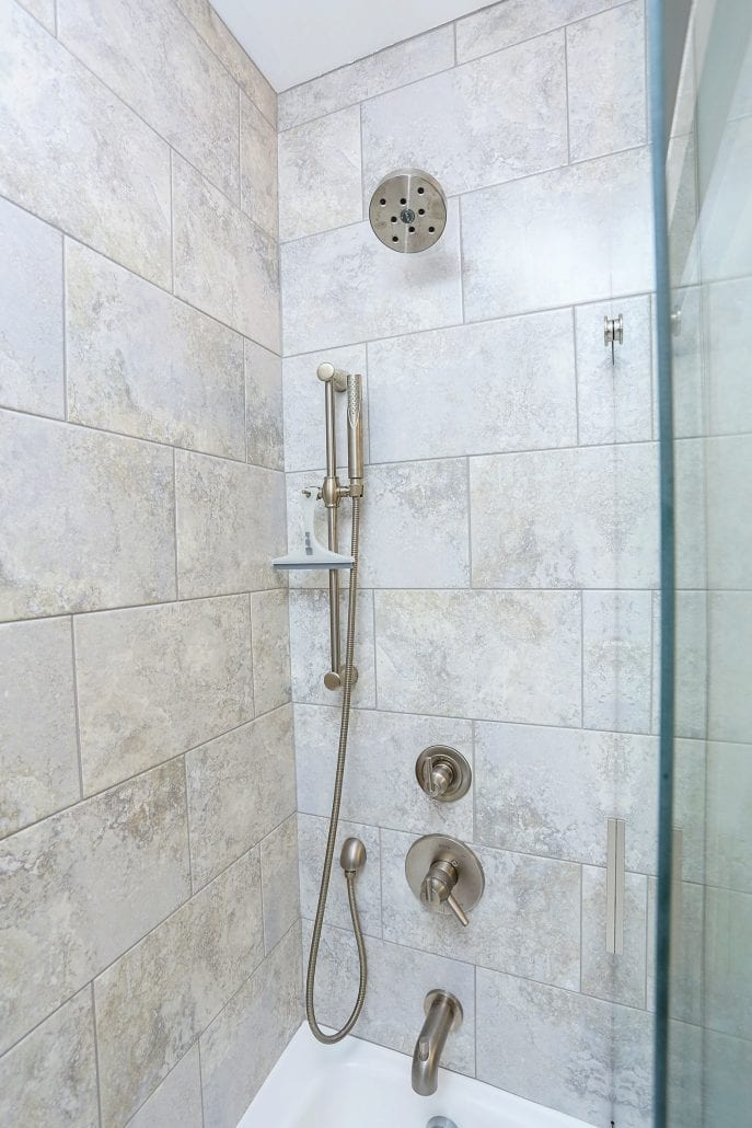 updated shower with two shower heads