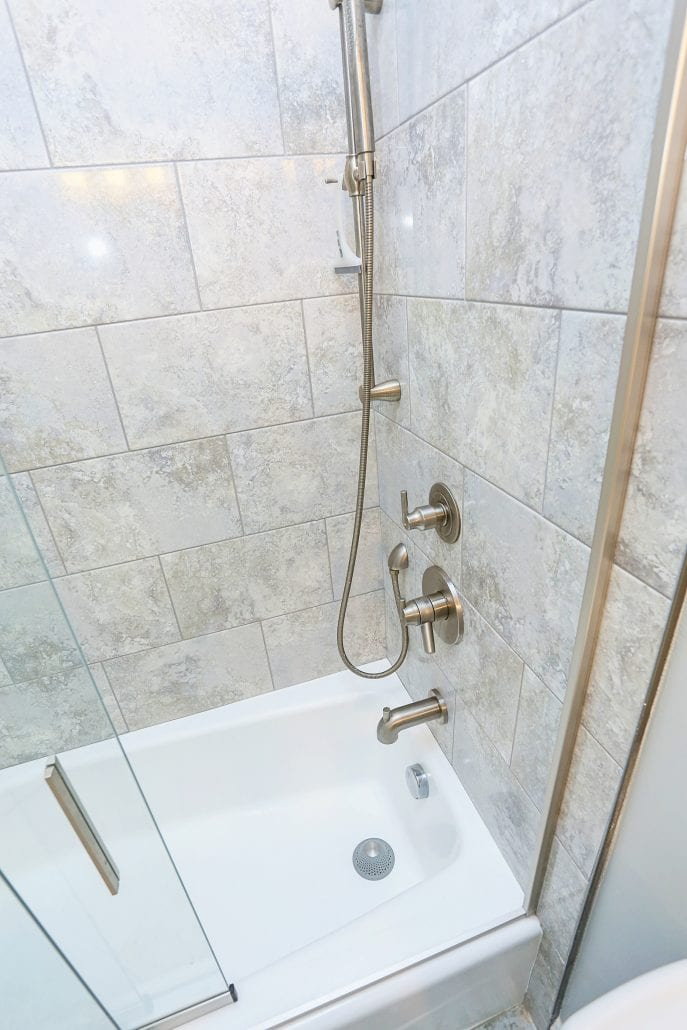 Updated shower with new tile, fixtures, and re-glazed tub