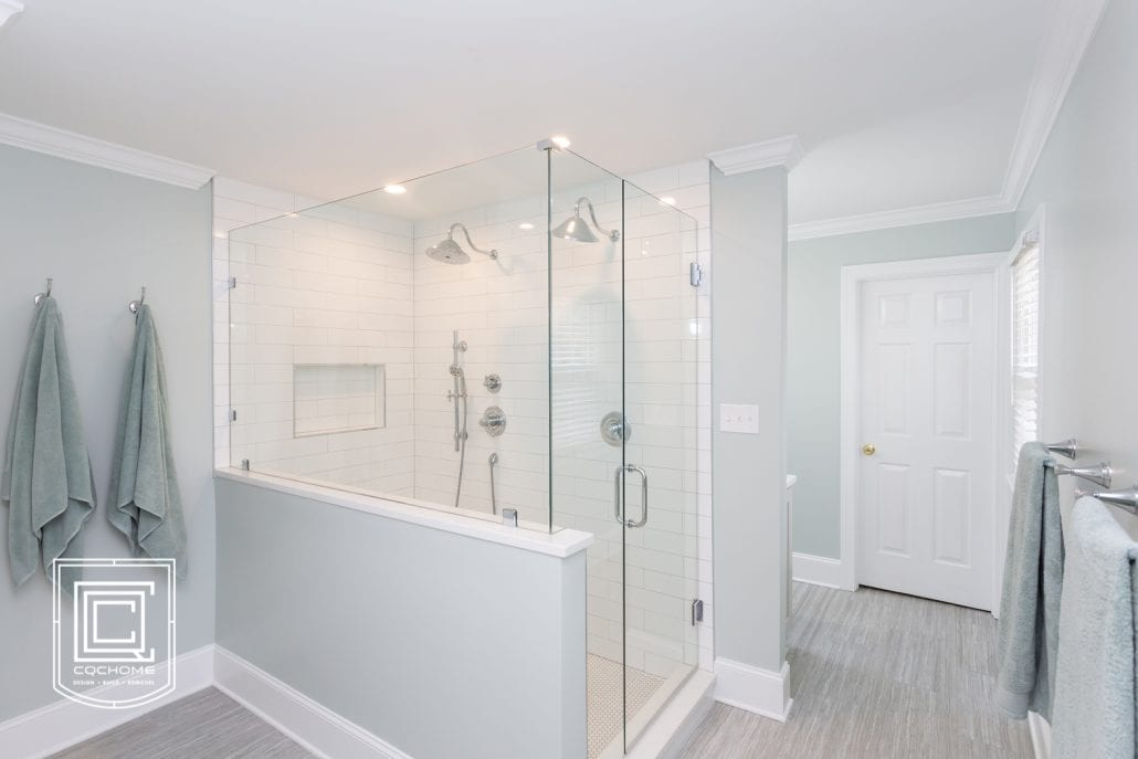 Gray and white bathroom with large walk in shower with white subway tile.